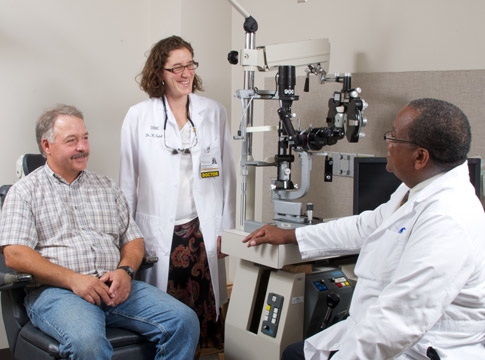 Oculoplastics fellow with patient and mentor