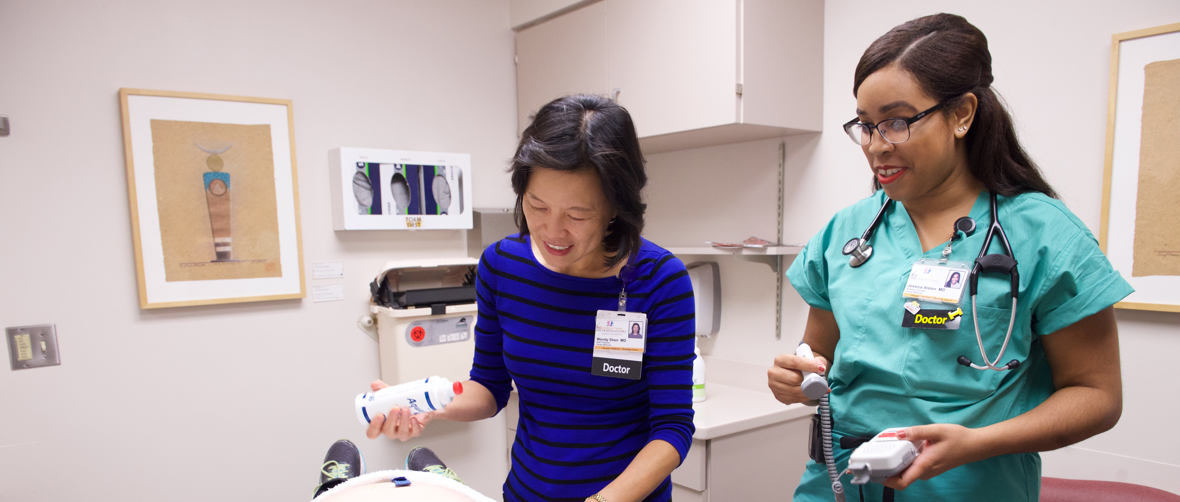 Dr. Shen with resident in the Family Medicine Clinic doing ultra sound on a pregnant patient.