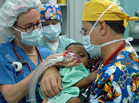 Child with surgeons